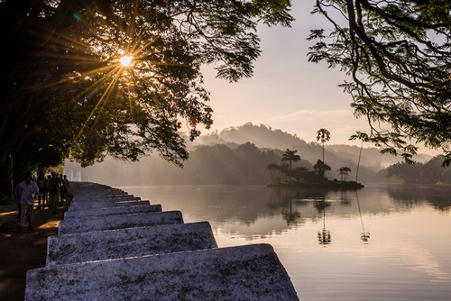 Sunrise at Kandy Lake and the island which houses the Royal